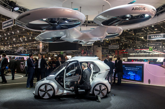 """The """"Pop.up next"""" concept flying car, a hybrid vehicle that blends a self-driving car and passenger drone by Audi, italdesign and Airbus is seen at the 88th Geneva International Motor Show on March 6, 2018 in Geneva, Switzerland. Global automakers are converging on the show as many seek to roll out viable, mass-production alternatives to the traditional combustion engine, especially in the form of electric cars. The Geneva auto show is also the premiere venue for luxury sports cars and imaginative prototypes. (Photo by Robert Hradil/Getty Images)"""