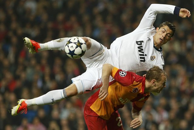 Real Madrid's Cristiano Ronaldo disputs a ball over Galatasaray's Semih Kaya during Champions League quarter-final, first leg soccer match at Santiago Bernabeu stadium in Madrid April 3, 2013. (Photo by Susana Vera/Reuters)