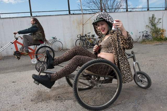 "A woman rides a custom bike during ""Bike Kill 12"" in the Brooklyn borough of New York City, October 31, 2015. (Photo by Stephanie Keith/Reuters)"