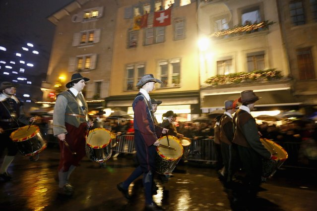 Drummers of the Compagnie 1602 take part in a procession in Geneva December 14, 2014. (Photo by Pierre Albouy/Reuters)