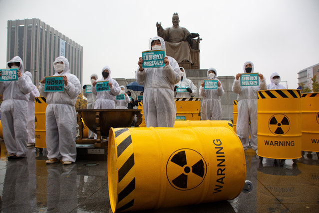 Environmental activists protest against nuclear power at Gwanghwamun Square in Seoul, South Korea, 01 November 2020. The rally was to raise public awareness about the harmful effects of radiation-tainted nuclear waste. (Photo by Jeon Heon-Kyun/EPA/EFE)