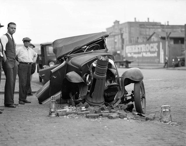 Car hits lamp post, 1929. (Photo by Leslie Jones)