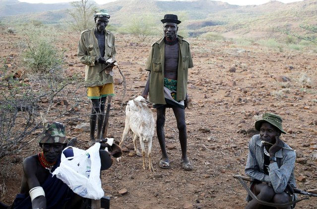 Turkana men stand outside a village in the Turkana region of the Ilemi Triangle December 20, 2014. (Photo by Goran Tomasevic/Reuters)