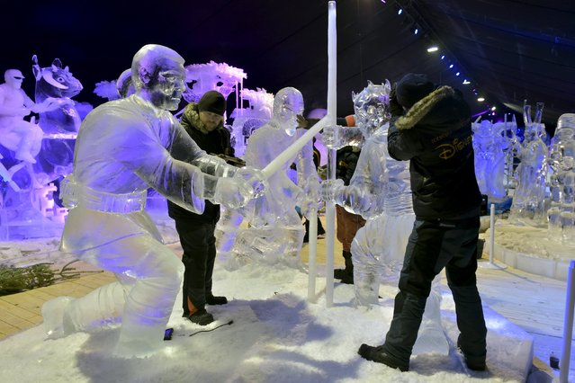 Various artists carve Star Wars characters for the ice sculpture festival in Liege, Belgium, November 13, 2015. (Photo by Eric Vidal/Reuters)
