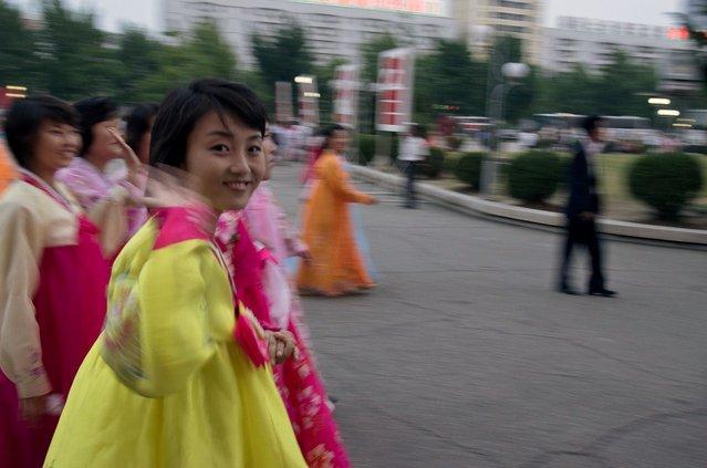 A Korean woman waves after the mass dance, September 2011. (Eric Testroete)