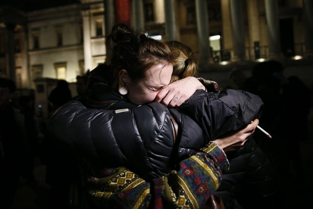 A woman cries during a vigil to pay tribute to the victims of a shooting by gunmen at the offices of weekly satirical magazine Charlie Hebdo in Paris, at Trafalgar Square in London January 7, 2015. (Photo by Stefan Wermuth/Reuters)