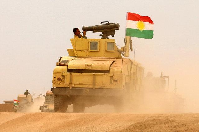 Kurdish Peshmerga military vehicle drive in during a battle with Islamic State militants at Jarbuah village near Bashiqa near Mosul, Iraq, October 28, 2016. (Photo by Ahmed Jadallah/Reuters)