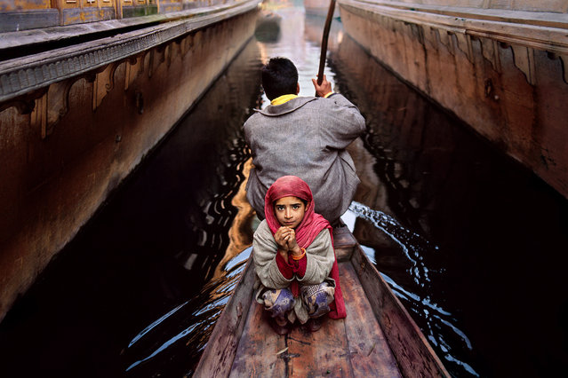 A father and daughter on Dal Lake in Srinagar, Kashmir, India, in 1996. (Photo by Steve McCurry)