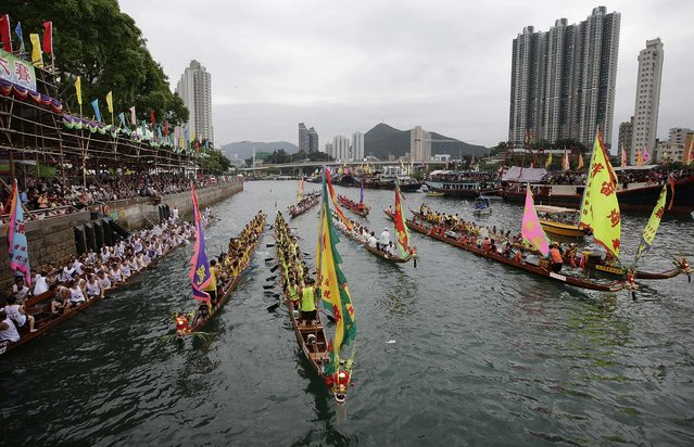 Crowds line the shore during the Aberdeen Dragon Boat Races in Hong Kong. (Photo by Jessica Hromas/Getty Images)