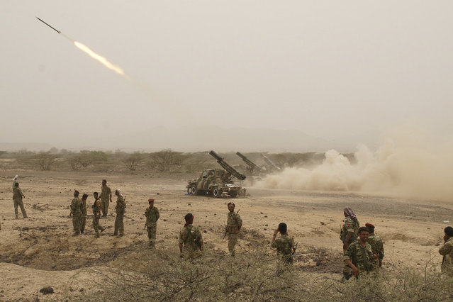 Yemeni army forces fire a missile towards of al Qaeda-linked militants positions in the southern province of Abyan June 4, 2012. (Photo by Reuters/Yemen's Defence Ministry)