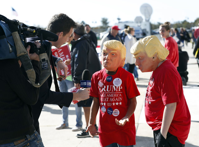Two young Donald Trump supporters are interviewed by a television reporter before a campaing rally for Republican presidential candidate Donald Trump Saturday, November 5, 2016, in Wilmington, N.C. (Photo by John Bazemore/AP Photo)
