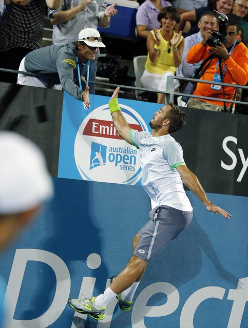 Viktor Troicki of Serbia leaps to high-five his coach, Australian Jack Reader, after defeating Mikhail Kukushkin of Kazakhstan in their men's singles final match at the Sydney International tennis tournament in Sydney, January 17, 2015. (Photo by Jason Reed/Reuters)