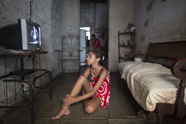 Jenifer Lopez, 12, watches television at her home in Havana January 9, 2015. (Photo by Alexandre Meneghini/Reuters)