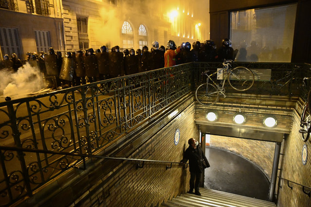 """Security forces take measures during protests against the French Government's proposed global security law bill on November 17, 2020 in Paris, France. The protesters include activists, reporters and unions who are concerned that Article 24 of the bill, which prohibits the diffusion of images of police """"with intention to harm"""", threatens the press freedom in France. Several MPs have criticised the bill's implications and President Macron has come under fire from national journalism unions and the UN for the proposals, relating to police accountability and the use of drones for street surveillance. (Photo by Julien Mattia/Anadolu Agency via Getty Images)"""