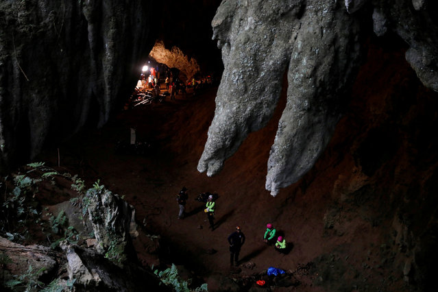 Rescue workers are seen in Tham Luang caves during a search for 12 members of an under-16 soccer team and their coach, in the northern province of Chiang Rai, Thailand, June 27, 2018. (Photo by Soe Zeya Tun/Reuters)
