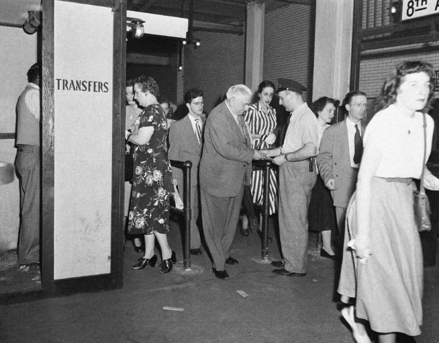 Changing from one subway line to another, passengers at the IND line's Broadway-Nassau St. station crowd through aisles to get free transfers from transportation employees under the city's new ten-cent fare, July 1, 1948. Transfer is required here where three lines meet, to prevent passengers from coming in from street and obtaining free rides. (Photo by Anthony Camerano/AP Photo)