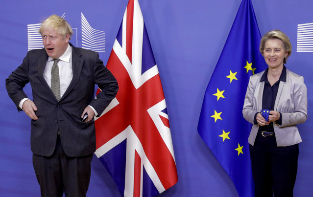In this Wednesday, December 9, 2020 file photo European Commission President Ursula von der Leyen, right, welcomes British Prime Minister Boris Johnson prior to a meeting at EU headquarters in Brussels. (Photo by Olivier Hoslet, Pool via AP Photo)