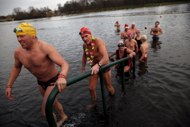 Swimmers climb out after taking part in the annual Christmas Day Peter Pan Cup handicap race in the Serpentine River, in Hyde Park, London, December 25, 2015. (Photo by Andrew Winning/Reuters)