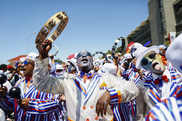 South African members of the Cape Minstrel bands attend the annual 'Tweede Nuwe Yaar' (second new year) carnival through the streets of Cape Town, South Africa, January 2, 2016. The annual parade dates back to the days of slavery when slaves were granted a holiday on this day each year. The carnival includes about 60 troupes of brightly-dressed minstrels and marching bands competing over several days for a grand prize as the parade also known as the Kaapse Klopse makes its way through the tourist lined streets of the city centre. (Photo by Nic BothmaEPA)