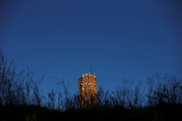 The tower of the San Agustin church is seen in the old village of Belchite, in northern Spain, November 13, 2016. (Photo by Andrea Comas/Reuters)