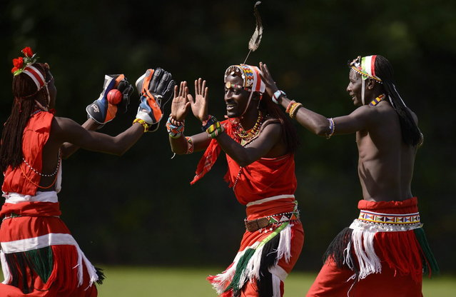 "Nissan Jonathan Ole Meshami (C) of the Maasai Cricket Warriors team from Kenya is congratulated after a dismissal by teammates in a match against English team ""The Shed"" during ""The Last Man Stands"" cricket tournament at Dulwich sports ground in South London September 1, 2013. (Photo by Philip Brown/Reuters)"