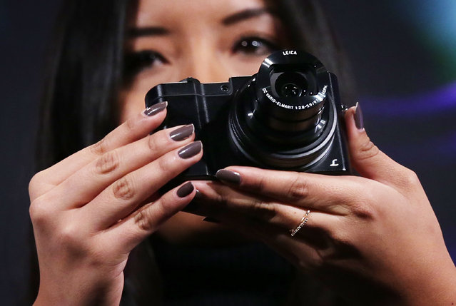 A woman holds up the Panasonic LUMIX DMC-ZS100 camera which features a 1-inch MOS sensor, a 10x zoom, 4K Photo and Post-Focus during a press event for CES 2016 at the Mandalay Bay Convention Center on January 5, 2016 in Las Vegas, Nevada. (Photo by Alex Wong/Getty Images)