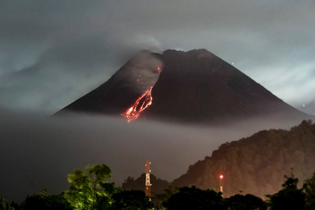 Lava flows down from the crater of Mount Merapi, Indonesias most active volcano, as seen from Kaliurang in Yogyakarta on April 14, 2021. (Photo by Agung Supriyanto/AFP Photo)