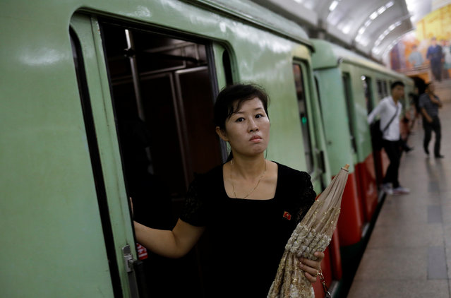 A woman gets off a train at a subway station in Pyongyang, North Korea on September 11, 2018. (Photo by Danish Siddiqui/Reuters)