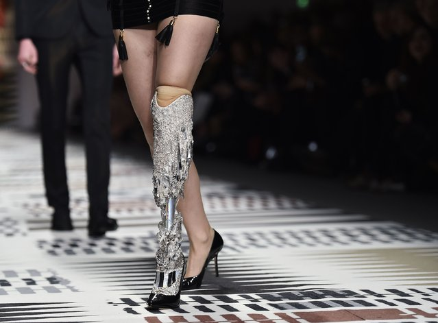 A model with a decorated prosthetic limb presents a creation during the Fashion for Relief charity catwalk show ahead of London Fashion Week in London February 19, 2015. (Photo by Toby Melville/Reuters)