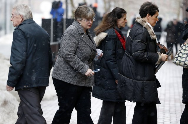Boston Marathon bombing survivor Karen Brassard, second from left, arrives with family and friends to federal court Thursday, March 5, 2015, in Boston, during the federal death penalty trial of Dzhokhar Tsarnaev. Tsarnaev is charged with conspiring with his brother to place two bombs near the Boston Marathon finish line that killed three and injured 260 people in April 2013. (AP Photo/Michael Dwyer)