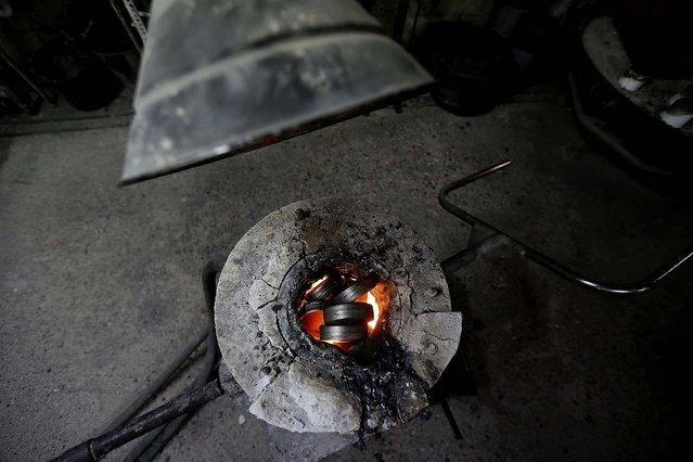 Steel melts in a oven before being poured in a form. (Photo by Stefan Wermuth/Reuters)