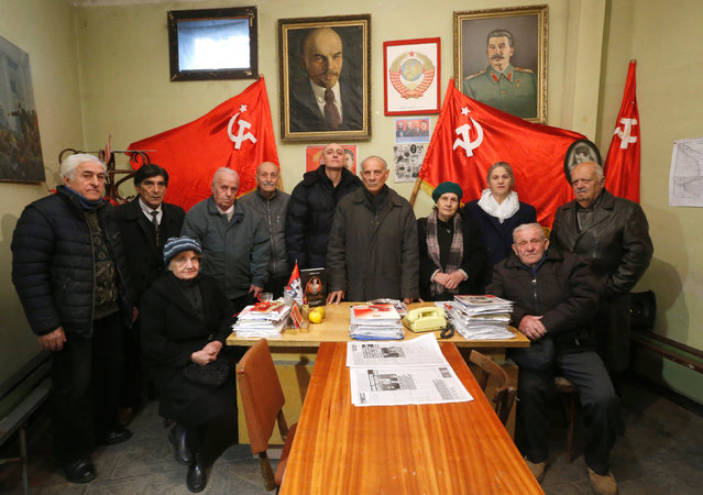 """Jiuli Sikmashvili (C), 77, a leader of the United Communist Party of Georgia, poses among other activists before a portrait at the party office in Tbilisi, Georgia, November 30, 2016. """"I cannot say how many people support us but we have regional offices all around Georgia"""", said Sikmashvili. """"Unfortunately the youth don't want to join our party, so our members are mostly elderly people"""". (Photo by David Mdzinarishvili/Reuters)"""