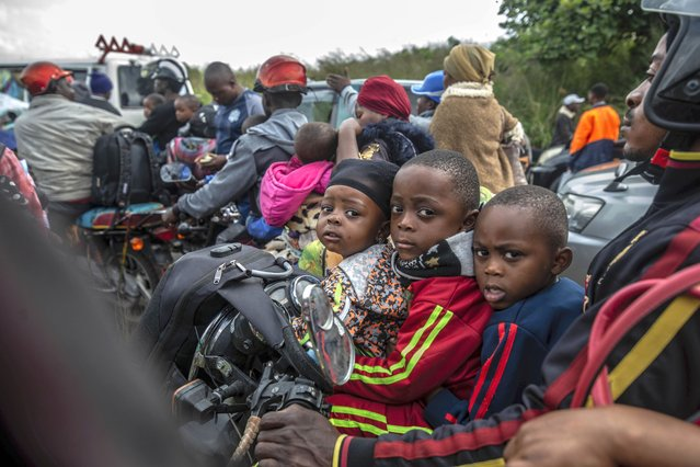 Residents flee Goma, Congo Thursday, May 27, 2021 , five days after Mount Nyiragongo erupted . A new eruption could occur at any moment, the military governor of Congo's North Kivu province, Lt. Gen. Constat Ndima Kongba, announced early Thursday. He ordered the evacuation of 10 of the 18 neighborhoods in the city of 2 million people. The center of Goma, which was spared when the volcano erupted last week, is now under threat, with activity being reported near the urban area and Lake Kivu, Kongba said. (Photo by Moses Sawasawa/AP Photo)