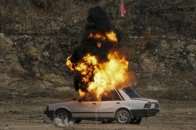 A vehicle is blown up during a course on blast scene investigation near Hua Hin, Thailand January 17, 2016. (Photo by Jorge Silva/Reuters)