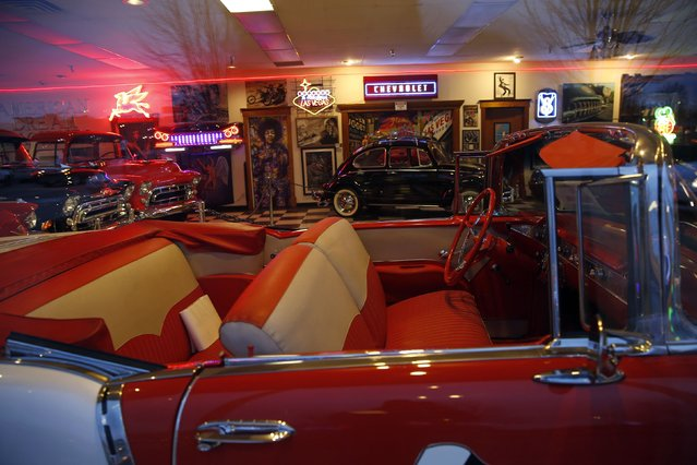 Classic antique cars are seen through the showroom window of an auto dealer in Des Moines, Iowa, January 23, 2015. (Photo by Jim Young/Reuters)