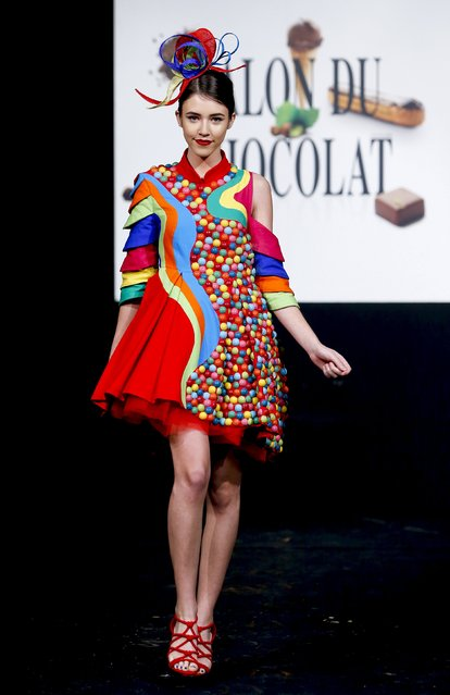 "A model dressed in an outfit made with chocolates presents a creation at the Brussels ""Le Salon du Chocolat"" chocolate fair February 5, 2016. (Photo by Yves Herman/Reuters)"