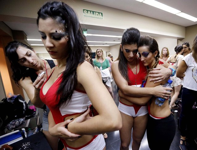 Participants wait their turn to compete in the Miss Pole Dance South America competition in Buenos Aires. (Photo by Enrique Marcarian/Reuters)