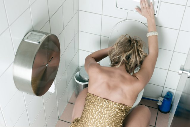 Woman throwing up in the toilet. (Photo by Kzenon /Getty Images)