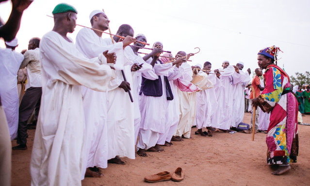 Sudan has one of the largest Sufi communities in the world. Sufism is a branch of Islam often seen as mystical due to its followers' pursuit of a personal, inner path to God. What unites each Sufi order is the belief that a path to God can be found through dhikr – absolute absorption in worship during which prayers, dances and spins may be repeated with enough fervour to induce a trance. (Photo by Ala Kheir, John Burns and Ibrahim Algrefwi/Brownbook)