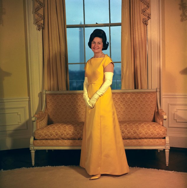 Lady Bird Johnson in Washington, D.C., U.S. in January 1965 in her inaugural gown designed by John Moore. She ordered the dress through Neiman Marcus. (Photo by Reuters/White House Photo/LBJ Library)