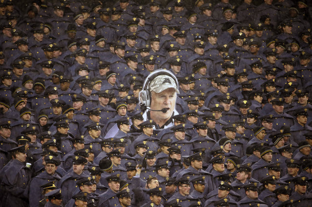 Army cadets hold a large photo of Army head coach Rich Ellerson during an NCAA college football game against Navy, Saturday, December 14, 2013, in Philadelphia. (Photo by Matt Slocum/AP Photo)