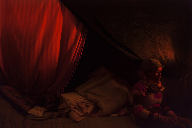 Yiogos Doukanaris, Greece. Shortlisted, Open Competition, Low Light. A refugee woman sitting inside her tent in Calais France. (Photo by Yiogos Doukanaris/Sony World Photography Awards)