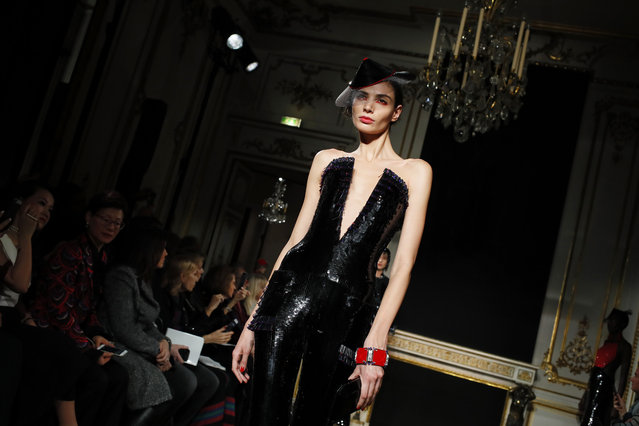 A model wears a creation for the Armani Spring/Summer 2019 Haute Couture fashion collection presented in Paris, Tuesday January 22, 2019. (Photo by Francois Mori/AP Photo)
