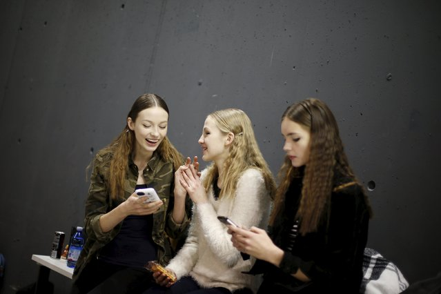 Models use their phones backstage of the Aquilano Rimondi Autumn/Winter 2016 woman collection during Milan Fashion Week, Italy, February 27, 2016. (Photo by Alessandro Garofalo/Reuters)