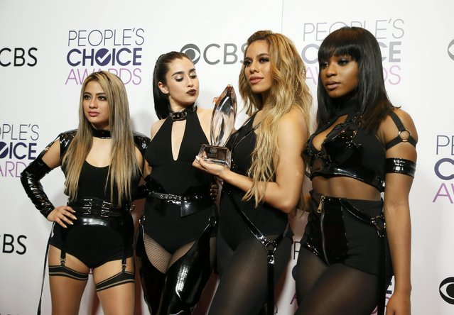 Members of Fifth Harmony pose with their award for Favorite Band backstage at the People's Choice Awards 2017 in Los Angeles, California, U.S., January 18, 2017. (Photo by Danny Moloshok/Reuters)