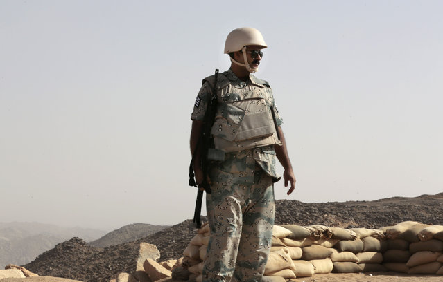 A Saudi soldier stands alert, on the border with Yemen, at a military point in Najran, Saudi Arabia, Tuesday, April 21, 2015. (Photo by Hasan Jamali/AP Photo)