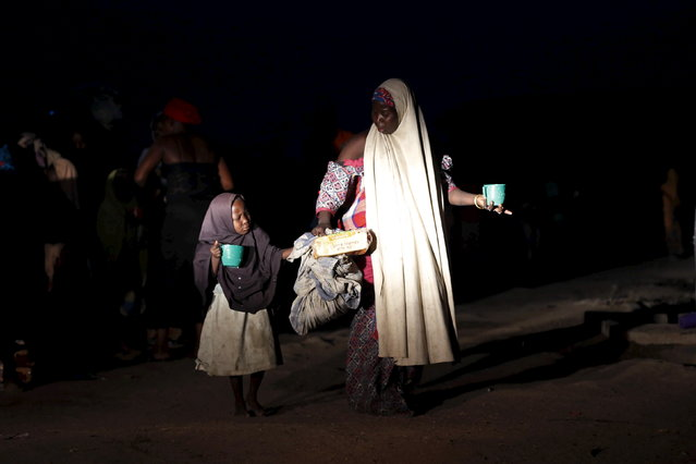 A girl and her mother rescued from Boko Haram in Sambisa forest by Nigerian military arrive at the Internally displaced people's camp in Yola, Adamawa State, Nigeria, May 2, 2015. (Photo by Afolabi Sotunde/Reuters)