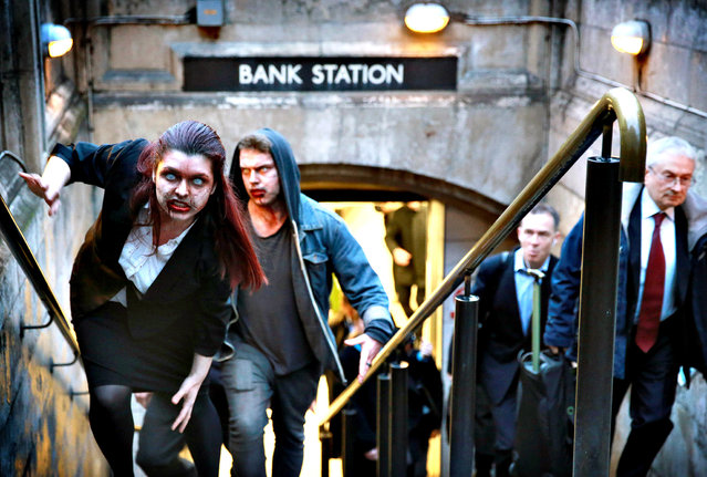 "Actors dressed as zombies exit Bank Station in London as peer-to-peer lender RateSetter highlights the issue of ""zombie"" savings accounts with  lifeless returns, on January 15, 2014. The independent study commissioned by RateSetter found that 79% of Britons do not check their savings returns against inflation, with some falling as low as 0.1% earning just  1 a year on savings of  1,000. (Photo by Matt Alexander/PA Wire)"