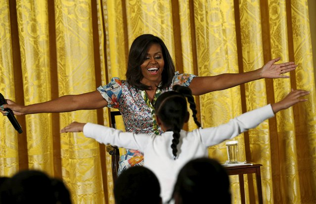 U.S. First lady Michelle Obama opens her arms as Anaya Brodie runs onstage for a hug during the White House's annual Take Our Sons and Daughters to Work Day in Washington April 22, 2015. (Photo by Kevin Lamarque/Reuters)