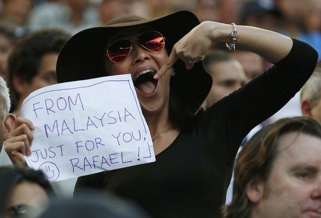 Tennis, Australian Open, Melbourne Park, Melbourne, Australia on January 27, 2017. A supporter of Spain's Rafael Nadal holds a sign during his Men's singles semi-final match against Bulgaria's Grigor Dimitrov. (Photo by Issei Kato/Reuters)
